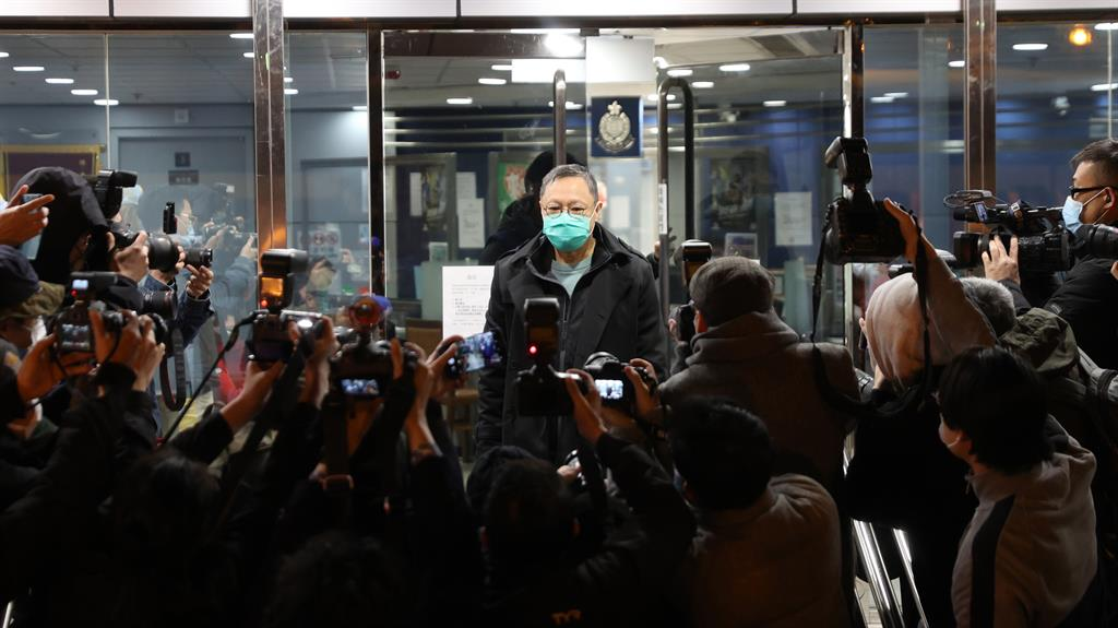 Vanishing freedoms: Activist Benny Tai Yiu-ting talks to media after being bailed PICTURE: EPA