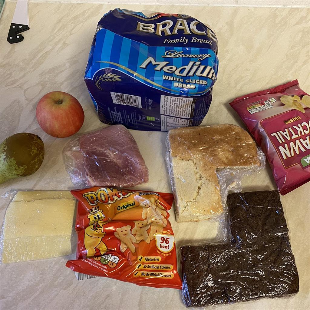 Doesn't add up: Dad Simon Young collected what he was told was a £30 'hamper' to feed his daughter for a week and opened it to find this selection PICTURE: SWNS
