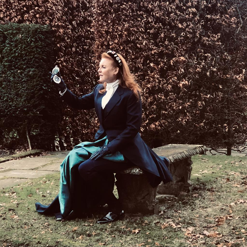 Bodice ripping yarn: The Duchess of York holds a compass while wearing Victorian dress to celebrate her book deal with Mills & Boon