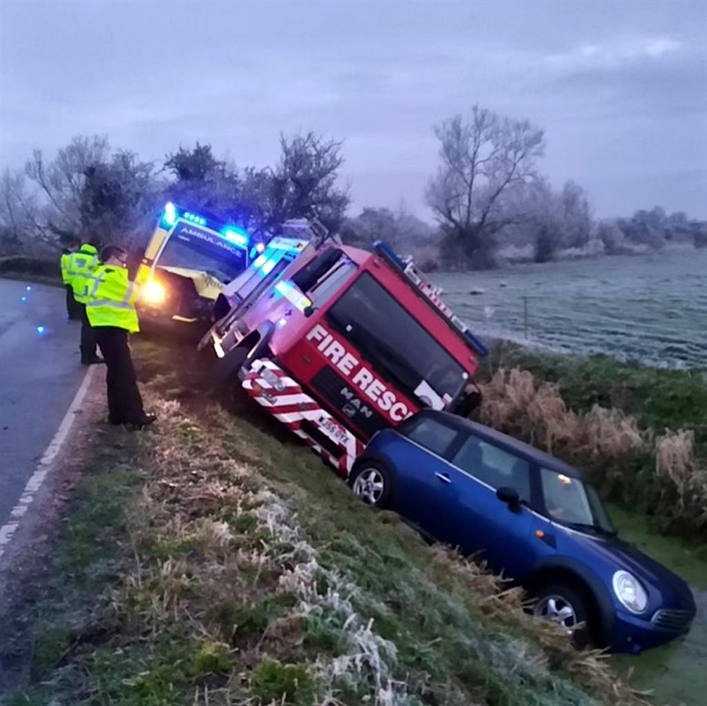 Icy grip: Fire engine and ambulance follow car into ditch due to black ice PICTURE: SWNS